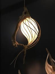cameron mathieson makes organic lighting using driftwood tree roots and shades made of anese paper