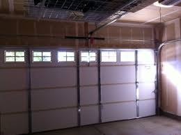 15 7 clopay garage door almond colored insulated short panel with colonial 509 windows