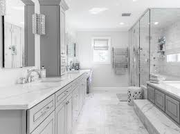 can this bathroom be any more beautiful the greige cabinets paired with the light countertop on the vanity are stunning the walk in glass shower and walk