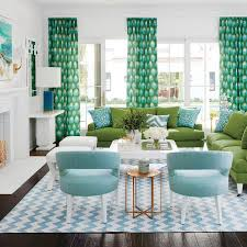blue and green living room with blue chevron rug