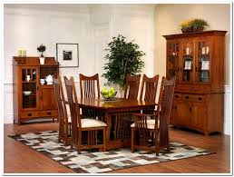 7 pieces old oak mission style dining room set with high back dining chairs with white fabric seats plus low dining table beside cabinet with drawer and