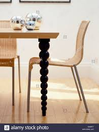 Wooden and metal chairs Homemade Metal Wickermetal Chairs At Wooden Table With Turned Spindle Legs In Modern Dining Room Keri Brown Homes Wickermetal Chairs At Wooden Table With Turned Spindle Legs In