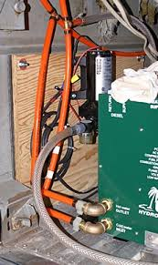 oasis combi itr the phase place fresh water pump on isolated plywood panel behind oasis combi