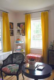 Appealing Yellow Curtain Panels For White Living Room Featuring Wall Art  Frames Plus White Corner Shelves