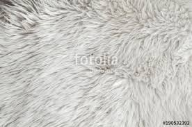 pink sheepskin rug background wool texture close up sheep fur