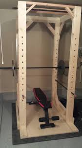 squat rack with safety bars and pull up bar installed