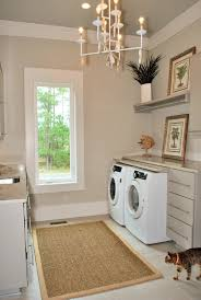 a cool eye catching chandelier is a great method of laundry room lighting