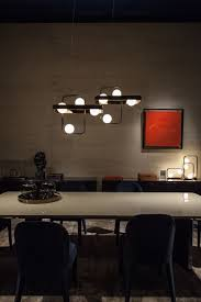 Image Luxury Living Infinty Lighting Fixtures Above The Dining Table From Fendi Casa Home Decorating Trends Homedit Idivacom Infinty Lighting Fixtures Above The Dining Table From Fendi Casa