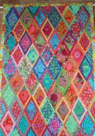 A quilt by Maree Rogers as shown in the Kaffe Fassett Collective ... & I want to make this quilt! Vivid color combinations in this outstanding  Kaffe Fassett pattern Adamdwight.com