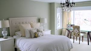Imposing White Bedroom With Wide Tufted Headboard Completed With Double  White Side Tables With Table Lamps