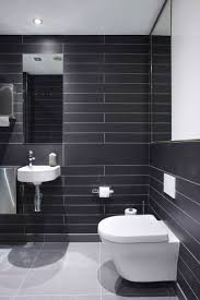 office wall tiles. Modern And Contemporary Office Bathroom Toilet. Featuring Floating Beautiful Dark Grey Wall Tiles