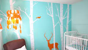 Adding a graphic wallpaper behind the crib is a great way to make a statement in your son's nursery. Baby Boy Nursery Wall Decor Baby Interior Design