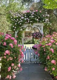 love this arbor in a cote garden arbors garden garden gates garden paths