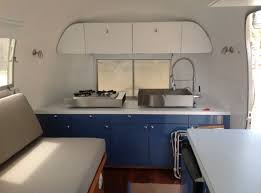 a refreshed cer van interior featuring clic navy blue cabinetry image closet crafters