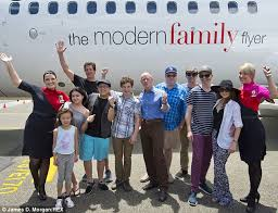 A modern trip: The Modern Family cast posed outside the Qantas jet with two  air