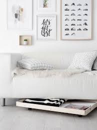 9 Ways to Add Storage Using the Area Under Your Sofa | Apartment Therapy