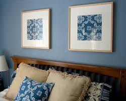 above is a picture of our bedroom where i simply framed two squares of fabric to tie the room together another easy inexpensive wall art project  on inexpensive wall art for bedroom with inexpensive wall art decorating with paper the cottage mama