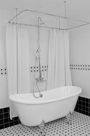 white wall tiles with clean white clawfoot tub using elegant metal rod for interesting bathroom ideas