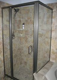 glass shower room with sliding glass door and silver steel frame also handler placed on the