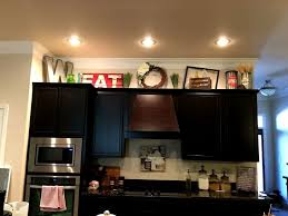 above kitchen cabinet decorations. Incredible Decorating Above Kitchen Cabinets With High Ceilings Cabinet Decorations N