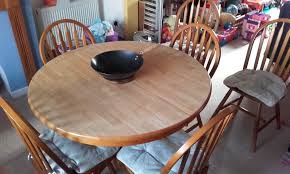 pine pedestal dining table and 6 matching chairs extendable from round to oval