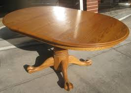 antique round oak table with claw feet tyres2c