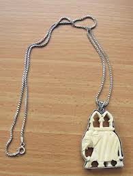 antique carved ivory elephant pendant silver frame silver chain