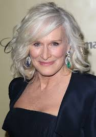 glenn close um blonde wavy curly hairstyle for