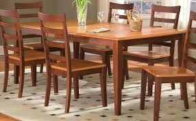 traditional vintage dining table idea with wooden fining chairs and white  patterned area rug and wooden