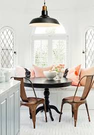 vintage breakfast nook with refined furniture and pink cushions
