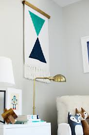 diy woven wall hanging from bathmat brittanymakes