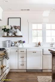 classic brass drawer pulls in white farmhouse kitchen la cornue stove
