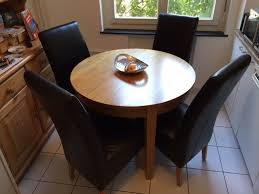 solid oak round breakfast dining table with 4 leather normandy chairs