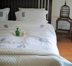 hand embroidered grey paisleys on white cotton duvet cover