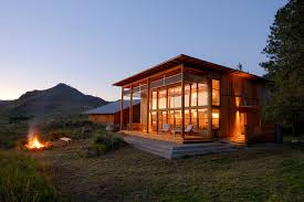 modern cabin photo of a mid sized rustic brown two story wood flat roof home in modern furniture design amazing contemporary furniture design