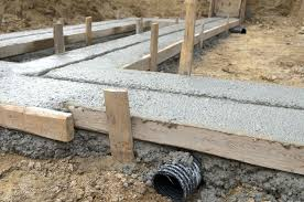 to pour concrete footings for stone walls