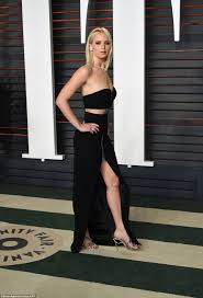 Jennifer Lawrence rocks sexy crop top and maxi skirt at Vanity.