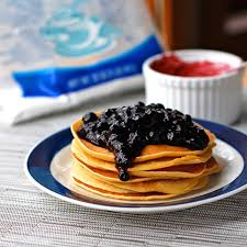 blueberry sauce fresh blueberries sugar vanilla and corn starch on top of pancakes