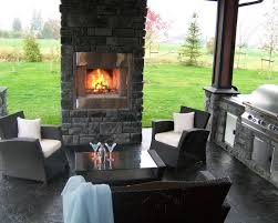 vintage patio with stone masonry outdoor fireplace plans