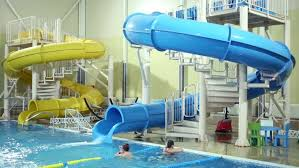 indoor pool house with slide. Big Houses With Indoor Pools LECHISCHEVO, RUSSIA FEB 21, 2015: People In Pool House Slide