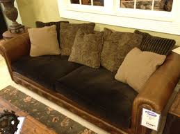 leather couch with fabric cushions