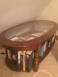large wooden coffee table unit with glass top good condition
