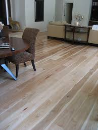 it features engineered wood flooring crafted in 8 wide boards up to 12 long and installed direct to a concrete slab