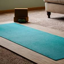 a yoga mat unrolled on the practice base the base is in a typical looking