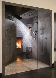 Double Shower Heads and a Fire place to warm you when you get out. Fire  place might be a bit over the top for a bathroom but I love the double  shower heads