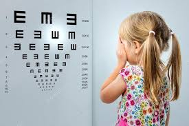 Little Girl Looking At Vision Test Chart Stock Photo