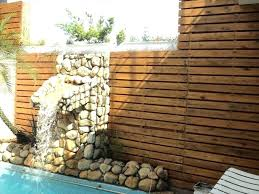 outdoor feature wall panels modern stacked stone fireplace outside wood panel