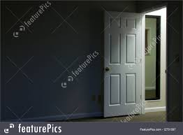 interior architecture looking towards a large blank wall with open door light is ing