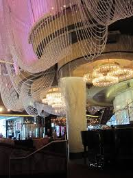a multi story las vegas strip lounge with gorgeous design three distinctive bars the chandelier at the cosmopolitan is a playground artwork exhibit