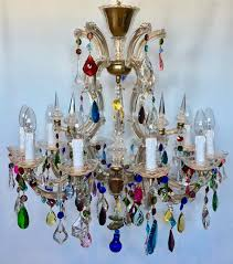 a beautiful 10 arm marie therese cage chandelier with prisms decorated with eclectic coloured crystal drops